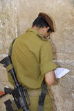 The Western Wall. Israeli soldiers praying at the Western Wall in Jerusalem Stock Photo