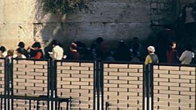 Western Wall curtain. Jerusalem, Israel - Circa 1981: Western Wall curtain to separate women from man praying in Old City of Jerusalem. Historic footage on 1980s stock video