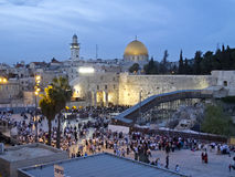 Western Wall and Dome of Rock at Passover Holiday. Dome of Rock and Western Wall at Jerusalem Old City holiday of Passover(Pesach). Jewish people are going to Stock Image