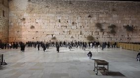 The Western Wall in Israel. Jewish people pray at the Western wall in Jerusalem stock video footage