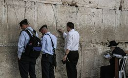 Western Wall, Jerusalem, 03.04.2015, Man sticking a note into th. Western Wall Jerusalem is also called the wailing wall or wall of weeping. It is one of the Stock Photos