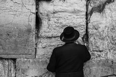 Old Orthodox Jew sticks a note into the western Wall or Wall of. Western Wall Jerusalem is also called the wailing wall or wall of weeping. It is one of the Stock Image