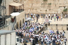 Western Wall on Jerusalem Day. Youth groups flood the Kotel plaza with Israeli flags on Yom Yerushalayim Royalty Free Stock Photo