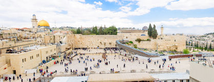 The Western Wall. JERUSALEM, ISRAEL - APRIL 10, 2015: The Western Wall crowded with Passover prayers, and Al-Aqsa mosque and the Dome of the Rock in the Royalty Free Stock Photo