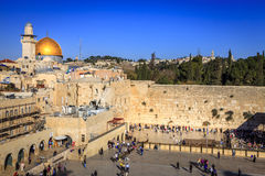 Western Wall. JERUSALEM, ISRAEL - NOVEMBER 15, 2012: Western wall (Wailing Wall) and the Dome of the Rock in Jerusalem.  This is one of the most sacred places Royalty Free Stock Photo