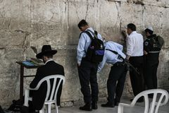 Western Wall, Jerusalem, 03.04.2015, Man sticking a note into th royalty free stock photos