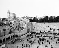 Western Wall On Shabbat. In Jerusalem, as sundown approaches on Shabbat, the plaza at the Western Wall becomes crowded with people. The Dome of the Rock and a Royalty Free Stock Image
