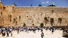 Western Wall or Wailing Wall or Kotel in Jerusalem. Timelapse. Plenty of people come to pray to the Jerusalem western wall. The Wall is the most sacred place royalty free stock photography