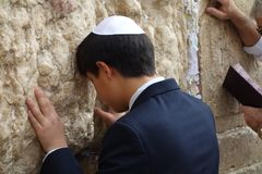 Young Man Praying at the Wailing Wall in the Old City of Jerusalem royalty free stock photo