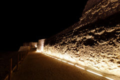 Western walls of Bahrain fort at night Royalty Free Stock Photography
