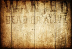 Western wanted sign on wooden wall. Old western wanted sign on wooden wall Royalty Free Stock Photography