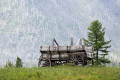 Western Ways. Scenic view of an Old Wagon with a mountain in the background Royalty Free Stock Images