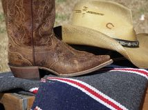 Western Wear. Western boots and hat on wooden box Royalty Free Stock Photos
