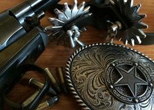 Western Wear. The standard wear of American cowboy: six shot revolver, Spurs, belt buckle, and ammunition Royalty Free Stock Image