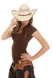 Western woman brown shirt look down touch hat Stock Image