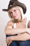 Western woman in cowboy shirt and hat Stock Photo