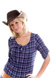 Western woman in cowboy shirt and hat Royalty Free Stock Image