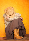 Western woman with her head down Stock Photo