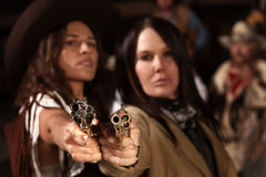 Western Women with Guns. Old western revolvers held by beautiful gun fighters Royalty Free Stock Photo