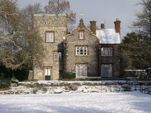 Westgate House In The Snow. This is an old building in Canterbury, UK. It stands in Westgate Gardens, and is made from flint, with many pretty details, such as Stock Images