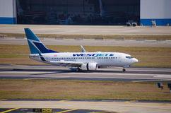 WestJet Boeing 737 landing at Tampa Int'l Airport Stock Photo