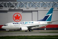 Westjet flygbolag Fotografering för Bildbyråer