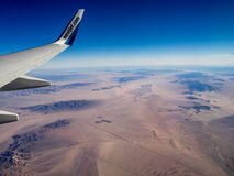 Westjet plane flying over the Mojave Stock Images