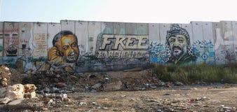 Westjordanlandsperre mit Wandgemälden von palästinensischen Führern Stockfoto
