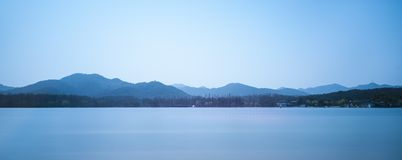 Westlake in hangzhou. With mountains Royalty Free Stock Photography