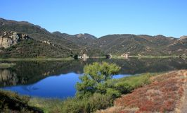 Westlake Reservoir. Sky and mountains reflected in a reservoir, California Stock Photo