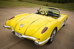Yellow 1958 Corvette Chevrolet classic car. Westlake, Texas - October 21, 2017: A back side view of a yellow 1958 Corvette Chevrolet classic car Royalty Free Stock Photography