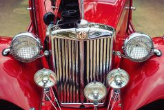 1951 MG TD Classic Car. Westlake, Texas - October 21, 2017: Front view, headlights and the grille of a red 1951 MG TD classic car Royalty Free Stock Images