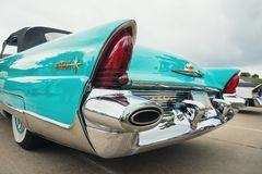 1956 Lincoln Premiere Convertible Classic Car. Westlake, Texas - October 21, 2017: Tail fin and tail light details of a turquoise color 1956 Lincoln Premiere royalty free stock photos