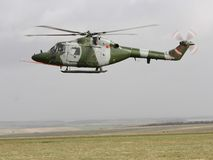 Westland Lynx. A Lynx belonging to the British army hovers to a stop in a filed in southern England stock images