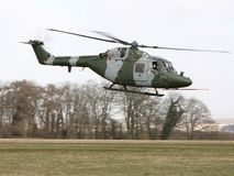 Westland Lynx. A Westland Lynx glides across a meadow in in southern England stock images