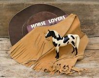 Westliche Lebensdauer des Cowboycowgirls noch für Pferdengeliebte Lizenzfreie Stockbilder