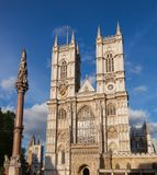 Westminster Abbey and Column London UK. Western facade of Westminster Abbey with Westminster Column, City of Westminster, Central Area of Greater London, UK royalty free stock photos