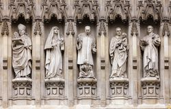Westminster Abbey facade detail with 20th-century Christian mart. Yrs Janani Luwum, Grand Duchess Elizabeth of Russia, Martin Luther King Jr., Oscar Romero and Royalty Free Stock Photos