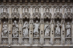 Westminster Abbey facade statues. Statues of saints on the facade of Westminster Abbey Royalty Free Stock Photo