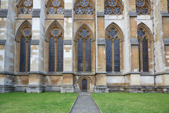 Westminster Abbey, Gothic church lateral entrance in London. Westminster Abbey, Gothic church lateral entrance on August 5, 2015 in London, UK. The cathedral is Royalty Free Stock Photos