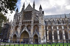 Westminster Abbey lateral view London. Westminster Abbey,  lateral view London and people in front of it visiting Royalty Free Stock Photo