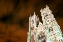 Westminster Abbey, London. A low angle view looking up at the façade of Westminster Abbey, Westminster, London.  An ultra long exposure blurs the night sky Royalty Free Stock Images
