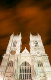 Westminster Abbey, London. A low angle view looking up at the façade of Westminster Abbey, Westminster, London.  An ultra long exposure blurs the night sky Stock Photo