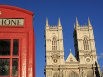 Westminster Abbey and London phone box. Traditional red London phone box and Westminster Abbey Stock Photo