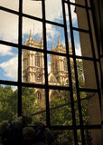 Westminster Abbey towers. View of Westminster Abbey through a window Stock Photo