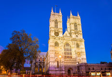 Westminster abbotskloster i aftonen - London Arkivbild