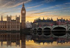 Westminster and Big Ben with reflections in the Thames river. Westminster and Big Ben during sunset with reflections in the Thames river, London Stock Photo