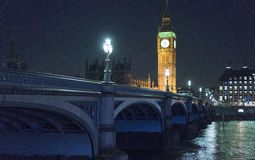 Westminster Bridge with Big Ben and Houses of Parliament at night. England United Kingdom Stock Photos
