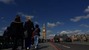 Westminster Bridge with Big Ben London Morning Timelapse. LONDON, UK - APRIL 27, 2015: Timelapse of pedestrians and traffic traveling along Westminster Bridge stock video footage