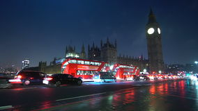 The Westminster Bridge and Big Ben at night - time lapse shot. Videoclip stock video footage
